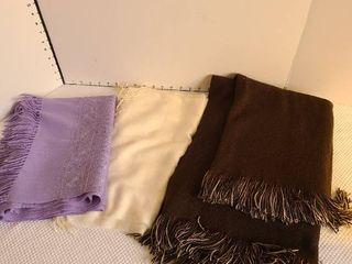 Two pashminas and a tan brown reversible shawl