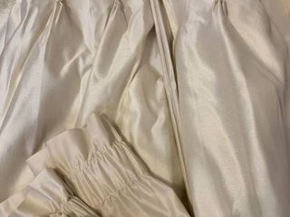 Pinch Pleated drapes with damaged bottoms and Valances