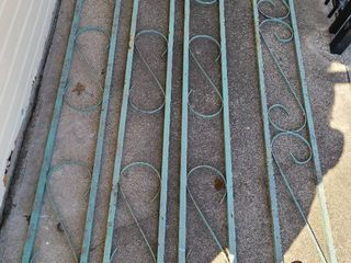 Decorative metal home accent pieces  7 feet long  9 inches wide  three match  one does not