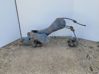Dog lawn Decor made from car parts