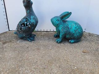 Duck and rabbit lawn statues
