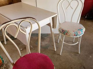 Table and 2 chairs 36 x 21in  and the drops are 10 in  each