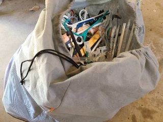 large bag full of assorted hangers