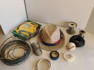 Assorted wires  hat  and a baseball