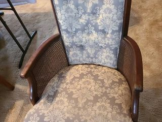 Upholstered chair with cane