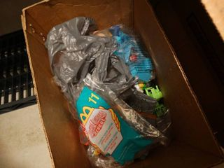Box of assorted Mcdonalds happy meal toys in packages