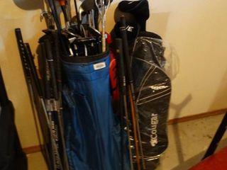 large lot of assorted golf clubs   2 bags