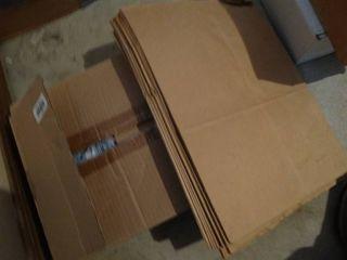 Box of new T shirts   paper sacks