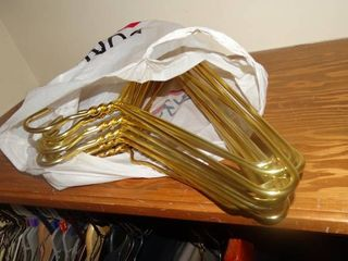 lot of Gold Colored Hangers