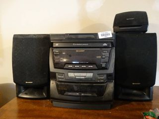 Sharp stereo w  3 CD changer   speakers