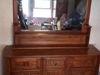 9 Drawer Dresser  68 x 19 x 32 in  tall  w Mirror Shelf  57 x 7 x 42 in  tall  It is 2 separate pieces