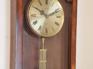 Dunhaven Battery Operated Wall Clock   needs AA batteries   12 x 25 in