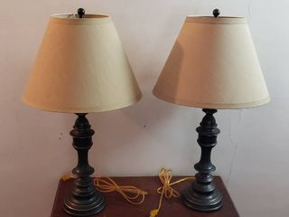 Pair of Antique Brass Table lamps   32 in  tall   one has a dented base   both work