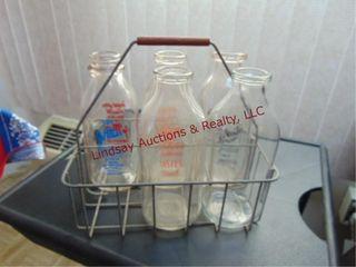 5 milk bottles w  holders SEE PICS