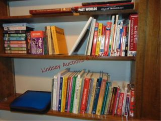 3 shelves of books  archeology  travel  collector