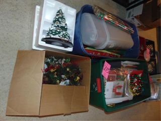 4 boxes of Christmas items  wrapping paper