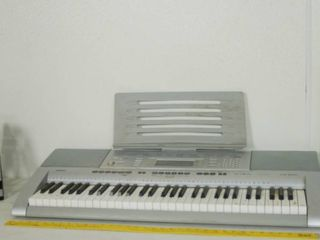Electronic Key Board  and Music Stand  Stand in Original Box   Key Board Needs Cord