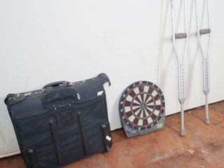 Black Suitcase   Dart Board and a Pair of Crutches