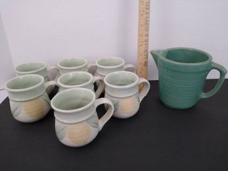 7 Pfaltzgraff cups and pitcher