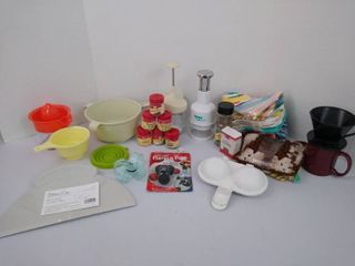 Assorted kitchenware including a pizza server  strainer  chopper  juicer and more