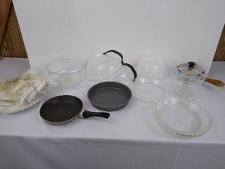 Kitchenware including 2 pans  3 pie pans  pot  cake decorating supplies and more