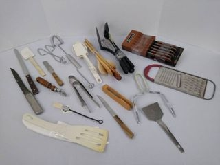 Kitchen supplies including knives  spoons  grater  spatulas and more