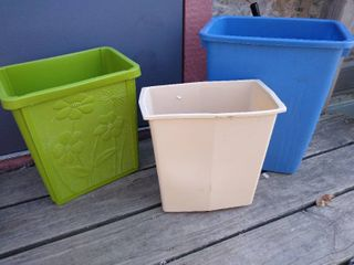 3 small wastebaskets