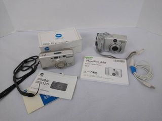 Minolta freedom zoom 125 digital camera and a Canon powershot A95 digital camera