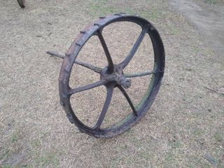 Metal farm equipment wheel w  attached axle