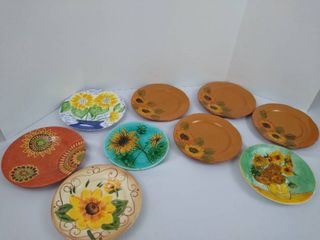 9 assorted sunflower themed plates