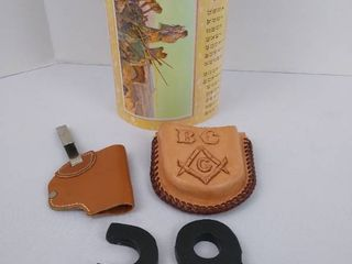 2 leather holsters and 7 Russell Western calenders