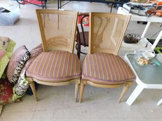 Pair of padded wooden dinette chairs with woven backs