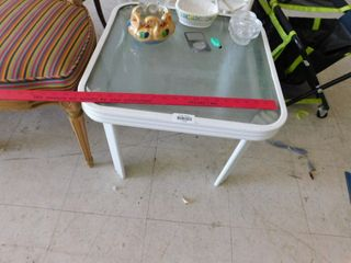 small square glass top metal table   contents not included