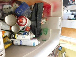 lot of assorted spray cans and metal tray
