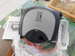 George Foreman Grill with books and tools