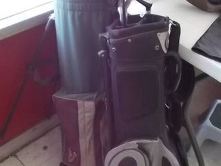 2 sets of golf clubs w bags   not complete
