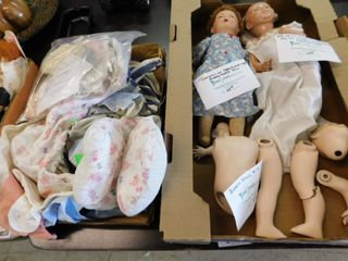 lot of vintage porcelain dolls and a kit and doll clothes