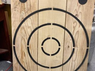 Huge wood man cave target with bottle opener made with three 2 x 12as and a half inch ply