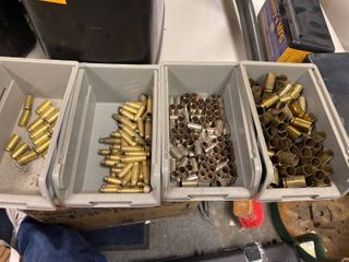 Mixed Brass including 5 7   45  9 mm and 40 10 empty bullet boxes and four trays