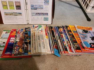 27 Nintendo Power magazines and a binder of hints and clues