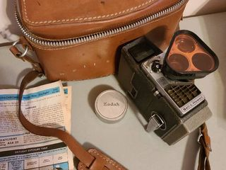 Vintage Bell and Howell movie camera with case