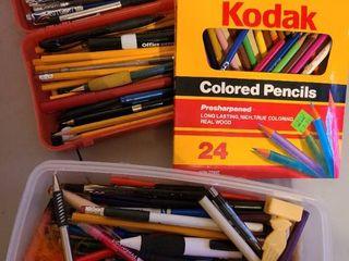 lot of pens  pencils  colored pencils