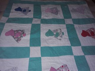Quilt  Has a few holes  And a few stains Size 76 x 80