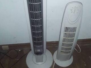 Two tower fans  One has remote