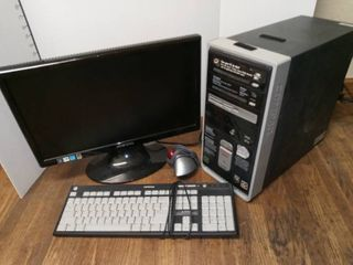 Compaq Desktop Computer with Keyboard and Hannspree 20 in Monitor and logitech Mouse