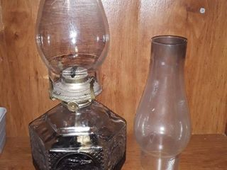 Oil lamp with an extra glass dome