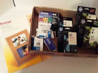 HP and EPSON different colored ink  Plus a pkg  of photo paper