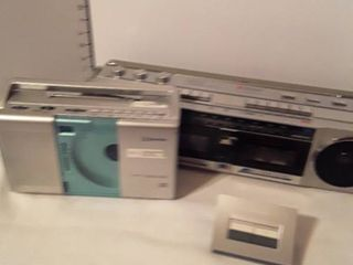 Emerson CD AM FM Radio and Sound Design 2 Cassette Players AM FM Radio  and a Radio Shack 2 way audio and video selector   Both Radios WORK