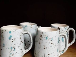 Set of 4 Speckeled Pottery Mugs  1 has a SURPRISE