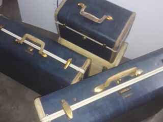 4 pcs  of Vintage luggage  The 3 pcs  of Blue luggage are the HIS and HER Set  The white one is an extra piece